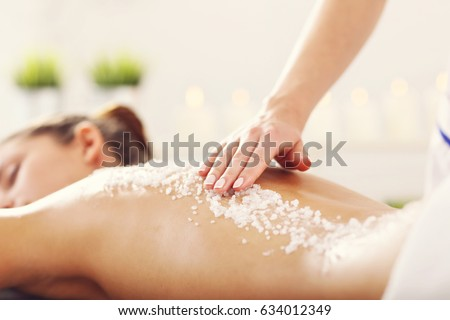 Beautiful woman having exfoliation treatment in spa #634012349