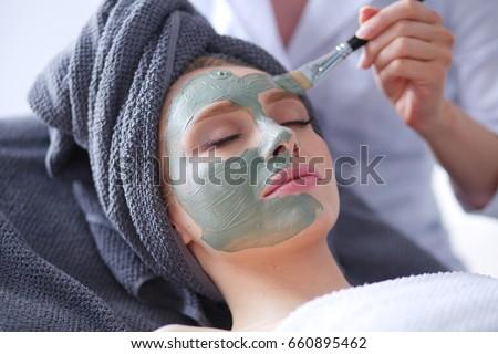 Beautiful woman having mask , lying on spa . Woman. Spa salon