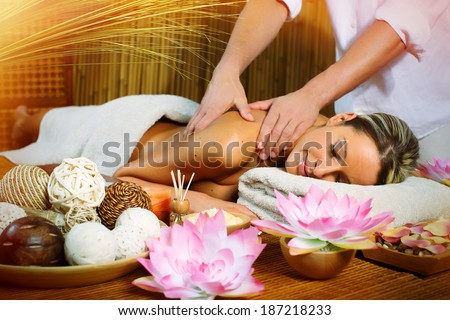 Beautiful woman having relaxing in spa massage salon