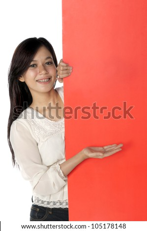 Beautiful woman hold blank red banner isolated over white background. You can put your message on the banner