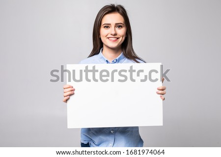 Beautiful woman holding a blank billboard isolated on white background Stock photo ©