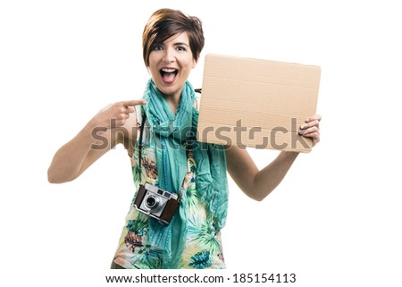 Beautiful woman holding a cardboard, isolated over a white background