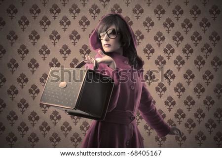 Beautiful woman holding a fashion bag