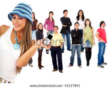 beautiful woman holding a phone in front of a group of people smiling and standing isolated over a white background