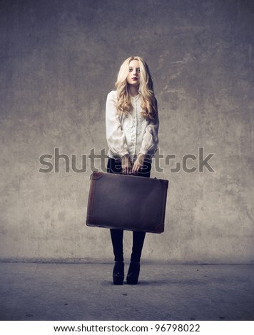 Beautiful woman holding a suitcase
