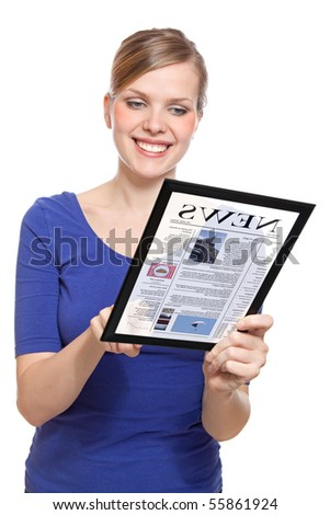 Beautiful woman holding a touchpad pc and reading a newspaper, isolated on white and focus on the eyes