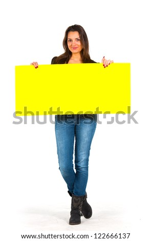 Beautiful woman holding a yellow, blank paper