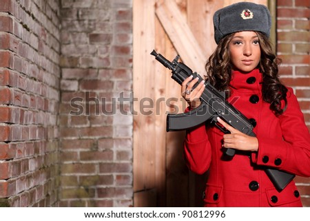 Beautiful woman holding an AK47 automatic rifle.