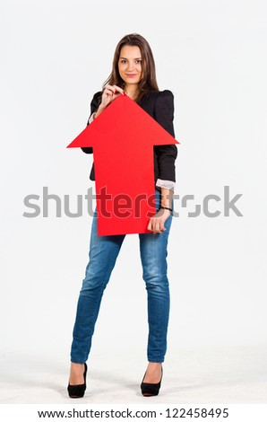 Beautiful woman holding an arrow pointing up - stock photo