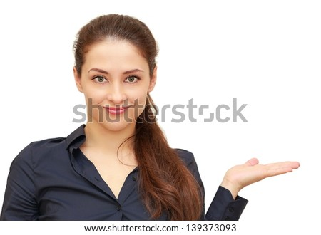 Beautiful woman holding and showing something empty on hand isolated on white background