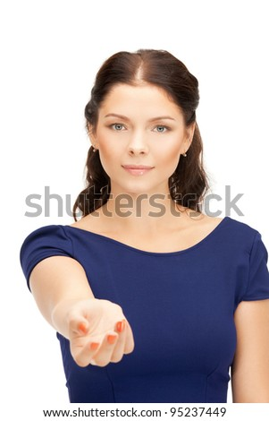 beautiful woman holding empty palm in front of her
