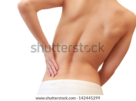Beautiful woman holding her back in sport pain isolated on white background