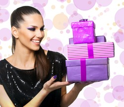 Beautiful woman holding purple gifts