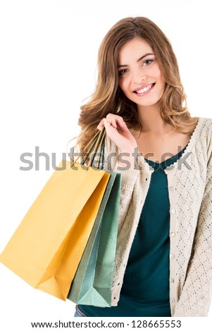 Beautiful woman holding shopping bags over white background