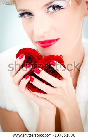 Beautiful woman holding tree roses.