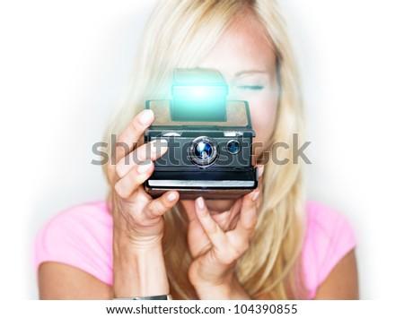 beautiful woman holds vintage photo camera