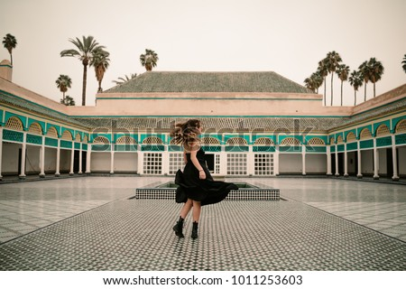 Beautiful woman in a beautiful Muslim place. Marrakech palace #1011253603