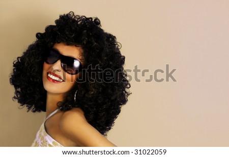beautiful woman in a big afro wig