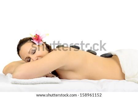 Beautiful woman in a  massage at beauty spa salon.
