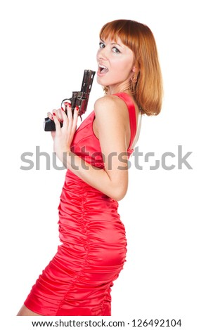 Beautiful woman in a red dress with a gun in his hand on a white background
