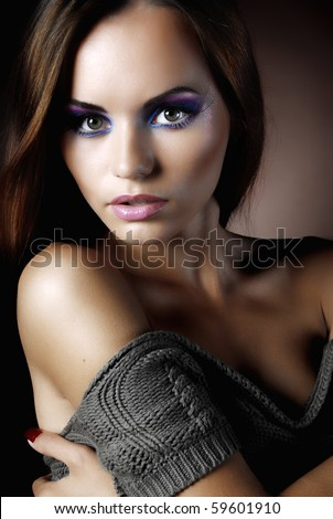 beautiful woman in a warm sweater - stock photo