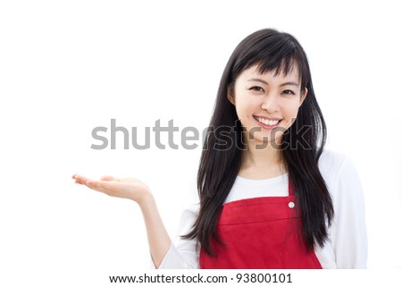 Beautiful woman in Apron promoting something, isolated on white background.