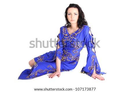 Beautiful woman in arabian dress sitting