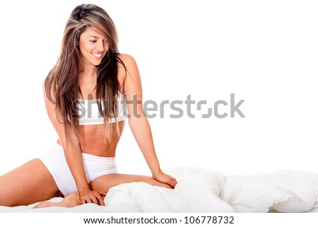 Beautiful woman in bed - isolated over a white background