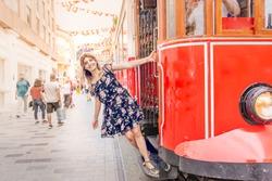 Beautiful woman in black dress hangs at nostalgic Istiklal tramway at istiklal street,Istanbul,Turkey