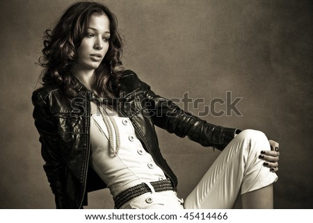 beautiful woman in black leather jacket, studio shot