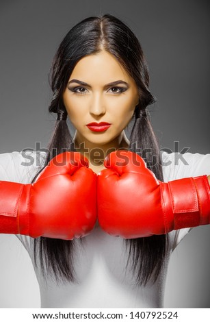 beautiful woman in boxing gloves