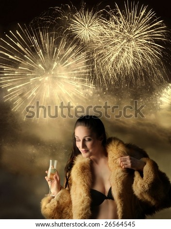 beautiful woman in bra and fur, drinking wine on a fireworks background - stock photo
