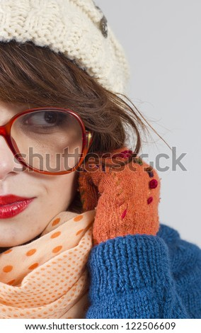 Beautiful woman in colorful winter clothes