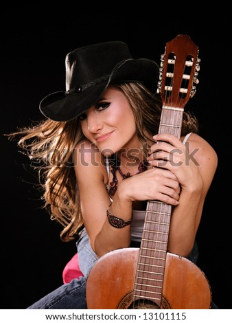 Beautiful Woman in Country Western Fashion Holing A Guitar