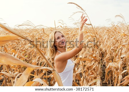 stock photo beautiful woman in dry corn field in autumn 38172571