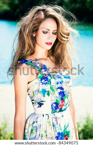 beautiful woman in elegant summer dress portrait by the river, summer day