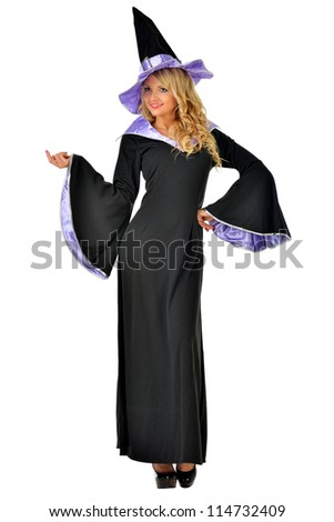 Beautiful woman in fancy dress of witch. Isolated image