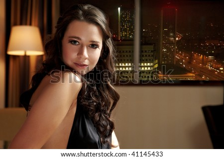 Beautiful woman in front of night city #41145433