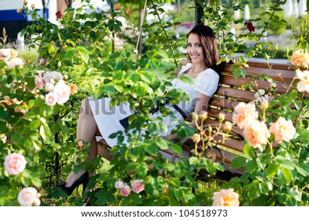 beautiful woman in garden with roses #104518973