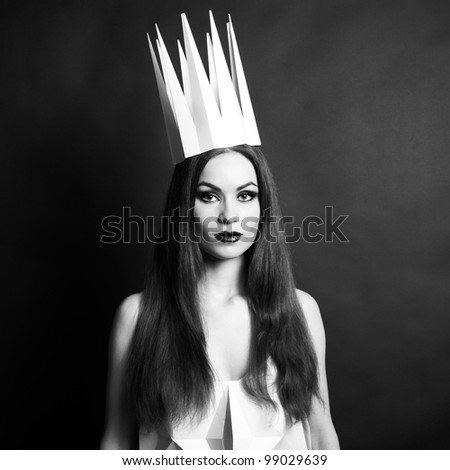 Beautiful woman in geometrical dress in crown. Fashion black and white portrait of queen. #99029639