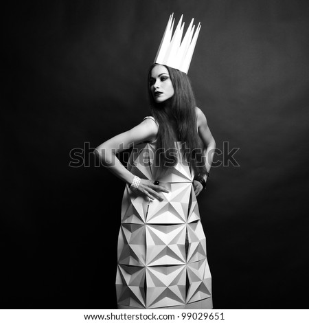 Beautiful woman in geometrical dress in crown. Fashion black and white portrait of queen. #99029651