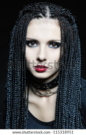 Beautiful woman in gothic shape with african pigtails .