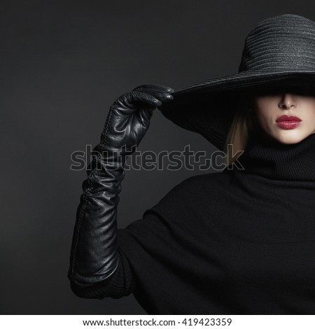 Beautiful woman in hat and leather gloves. Retro fashion model girl.black hat with large brim.halloween witch