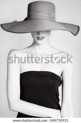 beautiful woman in hat. retro...