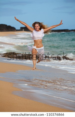Beautiful Woman in her Forties on the Beach