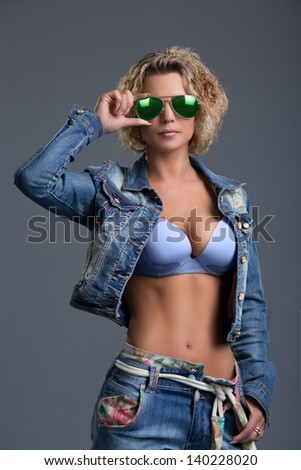 Beautiful woman in  jeans and jacket - stock photo
