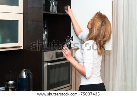 Beautiful woman in kitchen interior. One person only