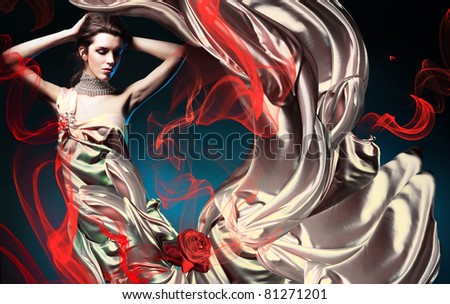 beautiful woman in long fairy dress and red abstract