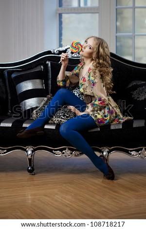 Beautiful woman in luxurious sofa