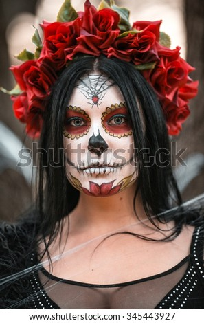 beautiful woman in makeup traditional mexican calavera skull katrina in the autumn forest in a